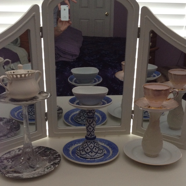 Vintage tea cups and saucers attached with stemware or candle sticks. Use as jewlery holders or votive candle holders.