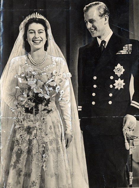 Still smiling: The newlyweds after their wedding in 1947...
