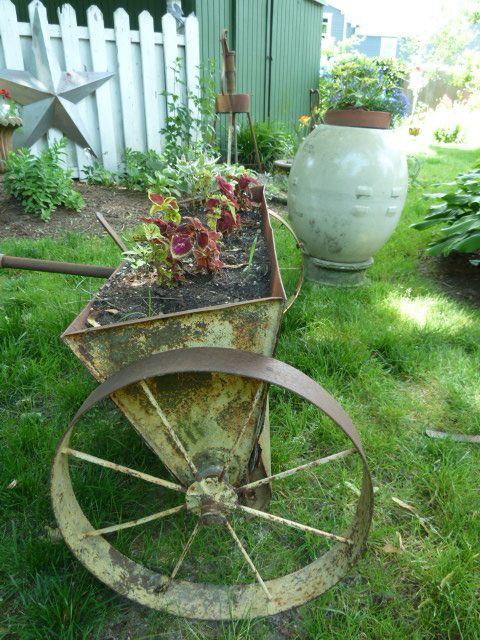 Objects In The Garden Antique Seeder As Planter.