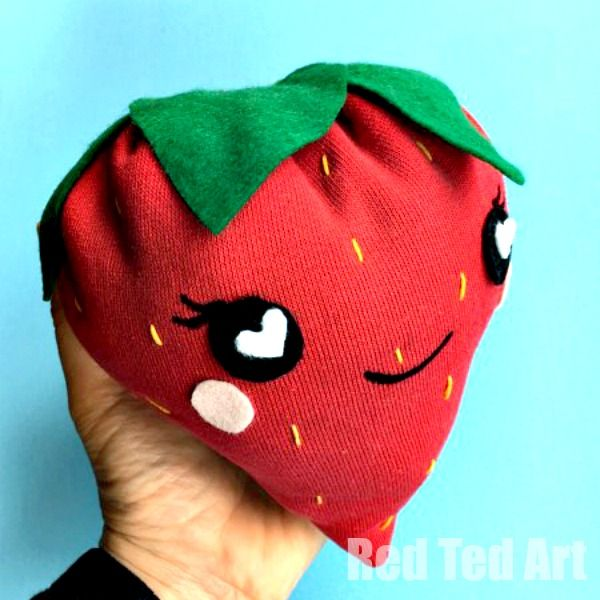 A super easy how to sew a strawberry softie project for kids. We upcycled an old school jumper to make these cute kawaii strawberry plushies.