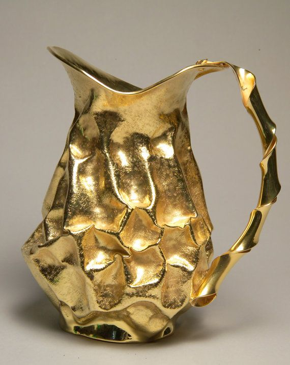 Pitcher by FrancoBlumer on Etsy. This silver-gilt pitcher comes from careful research of materials: silver seems modeled, metal is no longer as strong and rigid material, but as a moldable body, as if we could from time to time give the shape we want. Silver gr. 902 (1.98 lbs) https://www.etsy.com/shop/FrancoBlumer?ref=l2-shopheader-name