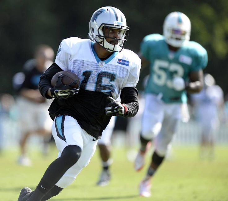 Carolina Panthers' Corey Brown (16) heads upfield after making a reception past the Miami Dolphins defense during a scrimmage at the Carolina Panthers Training Camp at Wofford College in Spartanburg, SC on Wednesday, August 19, 2015