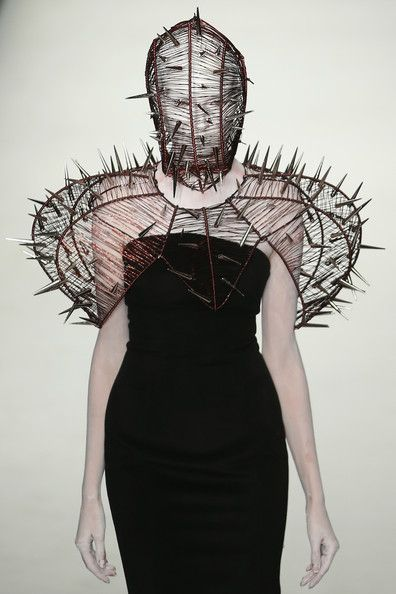 Hu Sheguang Haute Couture 2014 Repinned by www.fashion.net Sending to Lady Gaga reminds me of the avox's in Hunger games.