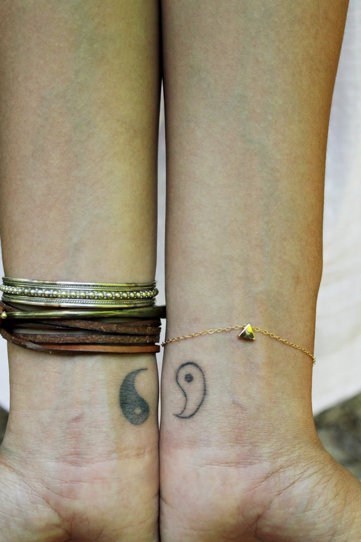 Great couple/friendship tattoo: Yin Yang symbol on the wrist | No Artist Information