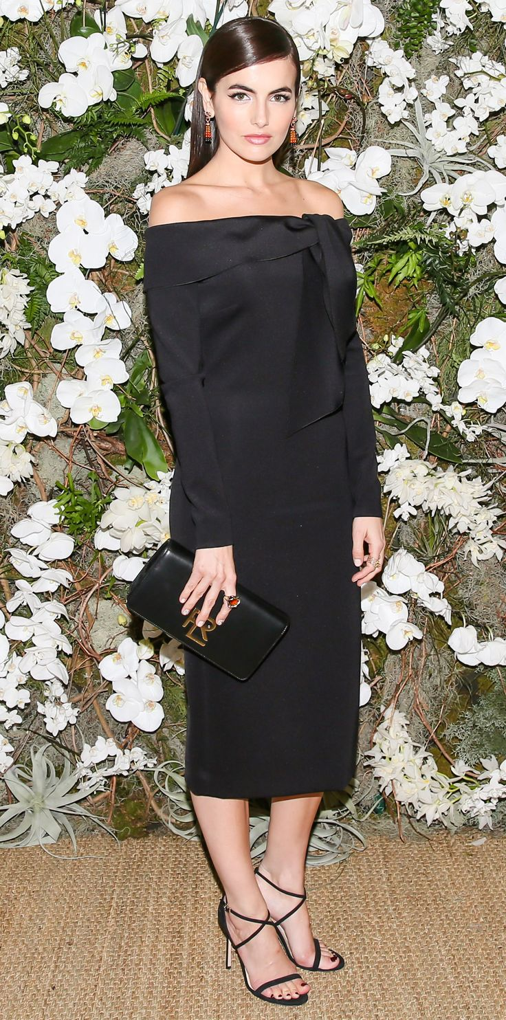 Camilla Belle knows how to stun in this sleek and elegant dress. She kept the attention on the off-the-shoulder silhouette by opting out of a necklace in favor of colorful earrings by John Hardy. A polished clutch and simple heels completed the look.