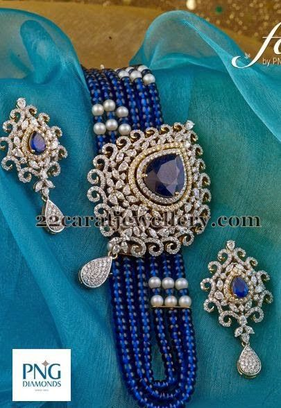 Multiple strings blue sapphire beads long chain with classic designer diamond pendant with faceted cut blue sapphire adorned in the cente...