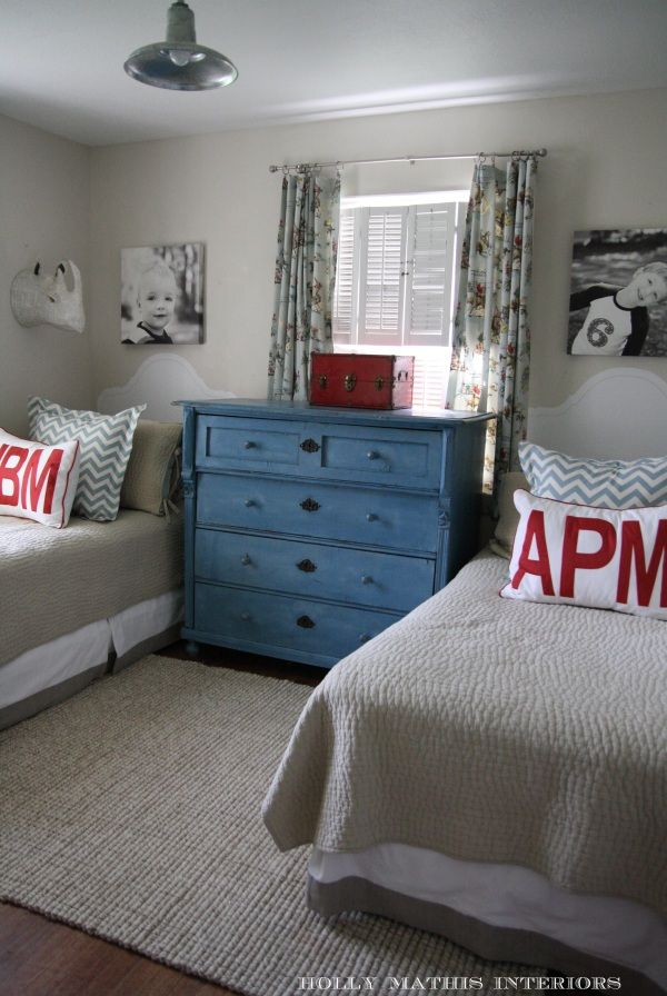 It looks like the headboards are painted on the wall, not sure if I love that...I definitely like the idea of putting the boys' initials on the pillows.