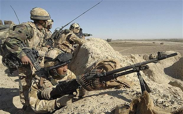 British Army Gurkhas take positions during a patrol in an area known as Hamburger Hill in Helmand province, Afghanistan, 2012.