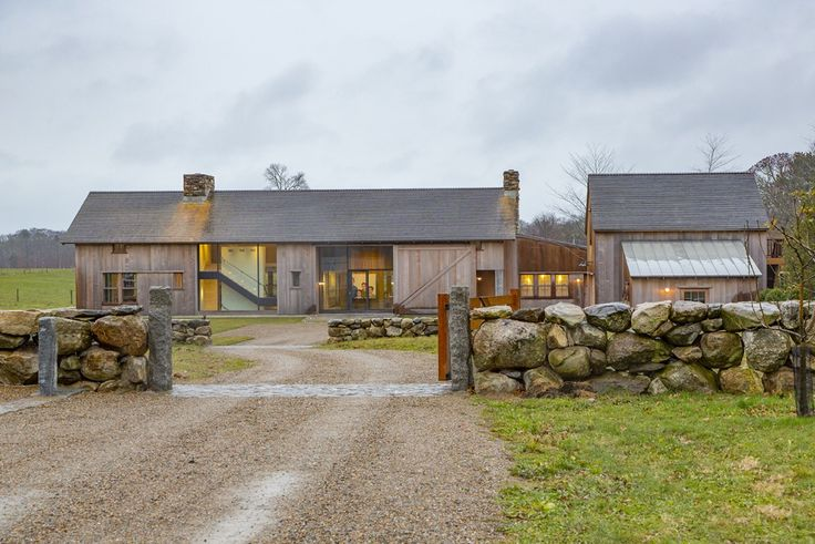 Vertical wood cladding on converted farm building with interesting glazing and slate tiled roof.