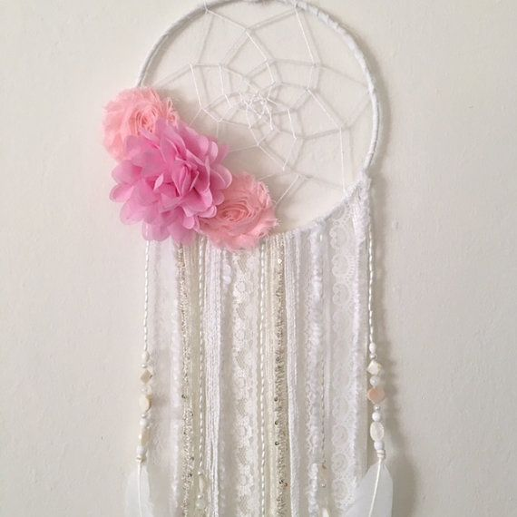Flower dream catcher by Inspired Soul Shop on Etsy. A dreamcatcher is beautiful boho chic decor for any bedroom, nursery, or living space. This flower boho dream catcher also makes a great baby shower gift or birthday gift. Perfect for nursery decor and boho chic decor!  Dream catchers are believed to fight off bad dreams, by capturing them in their web, and the morning light melts it away. Good dreams slide through the web, down the dreamcatcher strands and to the sleeper below.  Dream…