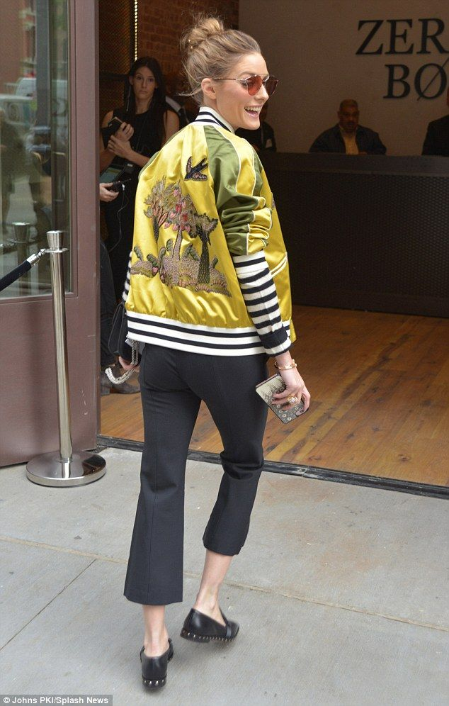 On trend: The 31-year-old teamed cropped trousers with a striped top and colorful satin bo...