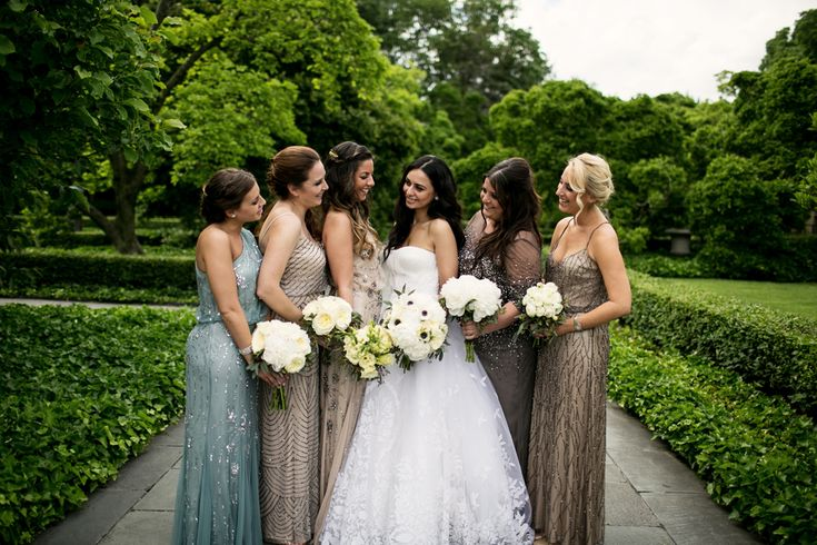 Love the delicate beading and neutral color palette/mix of styles for these bridesmaids gowns Crystall & Ryan | Jewish/Greek Wedding at Brooklyn Botanic Garden, New York, USA - Smashing the Glass | Jewish Wedding Blog