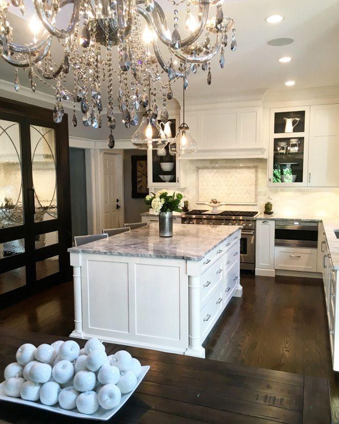 White kitchen with dark stained mirrored pantry cabinet. Kitchen. Kitchen…
