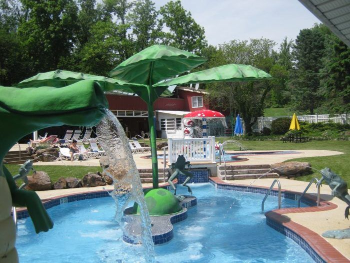 PA Campground- Lake in Wood- Soak up the sun as the water fountain sprays cool water over you or...
