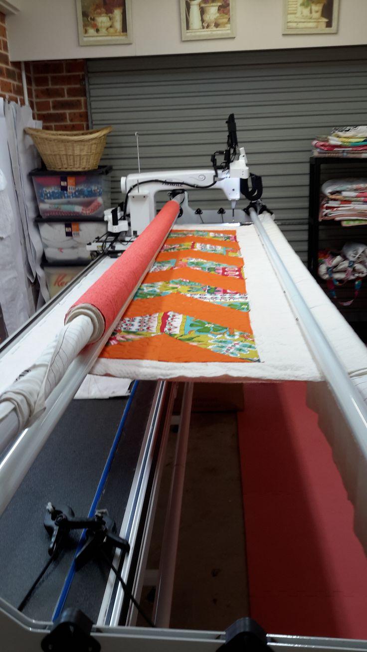 Just finished quilting this #orange, #chevron quilt.