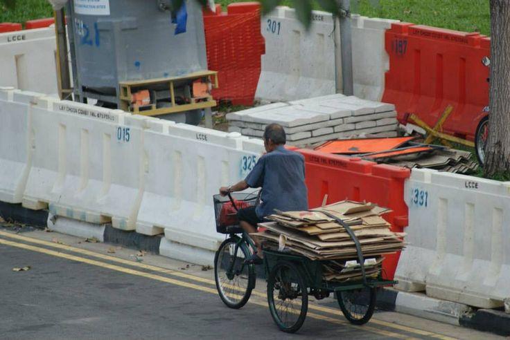 Cycle rickshaw man - singapore