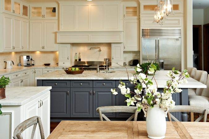 A white kitchen with dark cabinetry is a great pair. #designtips #ideas #home