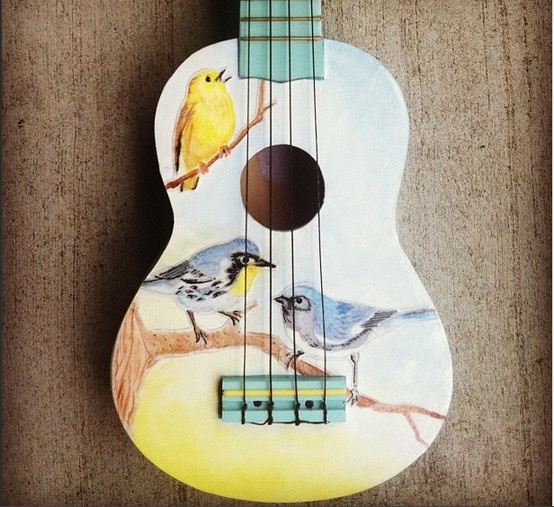Luthier Carley Gooley mod-podged a watercolor painting to the body of a Stagg ukulele. We think it looks gorgeous!