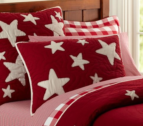 Star quilted bedding from Pottery Barn Kids.  Can get in chocolate, navy or red.