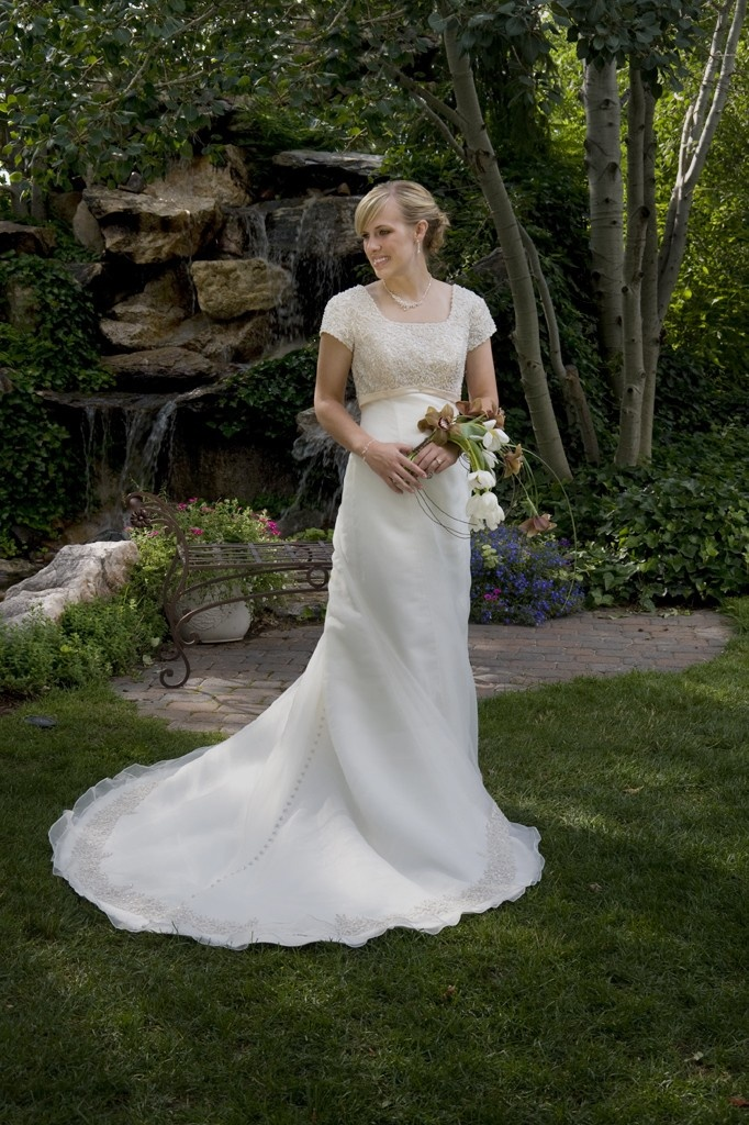 A stunning fitted wedding dress with a strapless