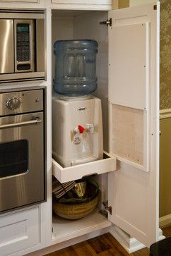 Hidden water cooler with hot and cold taps Superior Woodcraft, Inc.