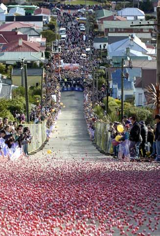 What better to do with the world's steepest street, Baldwin Street in Dunedin New Zealand, than organise a jaffa roll – where numbered balls of chocolate coated with a hard sugary outer are sent flying down in a moving wall of red and orange. The fastest jaffas finish the 79% gradient street in around 15 seconds, raising money for local charities.