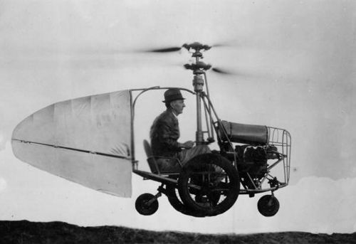 """1940 Jesse Dixon and his flying automobile. Accompanying note: """"Built by Jess Dixon of Andalusia, Ala. Can fly forward, backward or hover in the air. Runs on road or flys across country. 40 H.P. motor, air cooled, speeds to 100 m.p.h."""""""