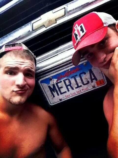 chevy, case IH, merica plates, and insanely HOT farm boys? this picture couldnt be more right on the money!