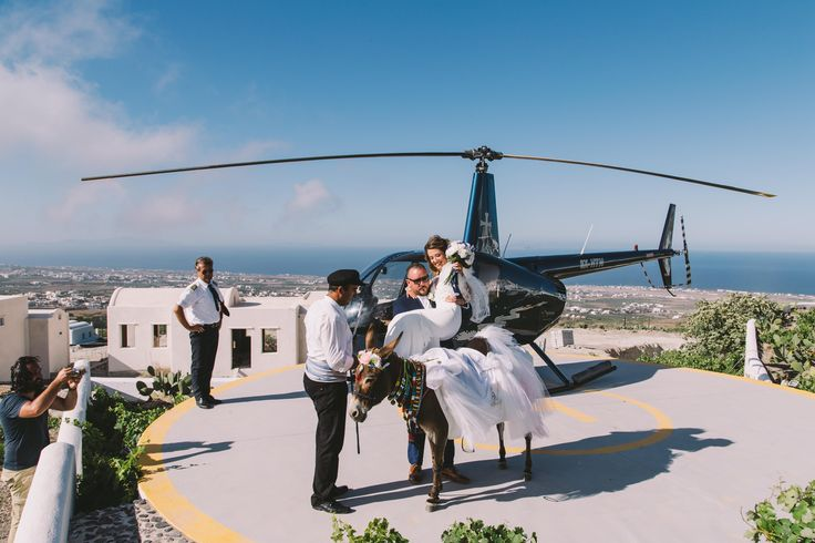 #wedding #weddingphotographer #weddingideas #helicopter #pilot #donkey #bride #groom  #white #dress #smiles #flowers #hug #beautiful #view #unique #moments #oia #santorini #ios #folegandros #mikonos #miltoskaraiskakis