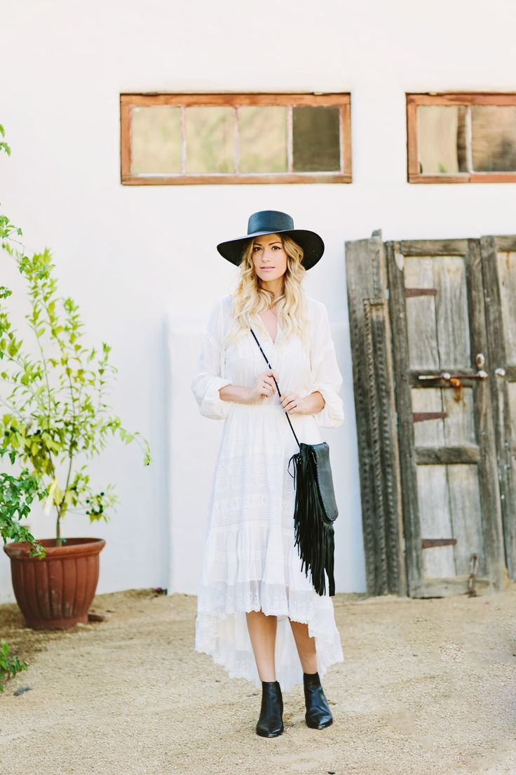 Dash of Darling styles a Spell Designs matching white top and skirt with a Janessa Leone straw boater hat and a Jennifer Haley black fringe…