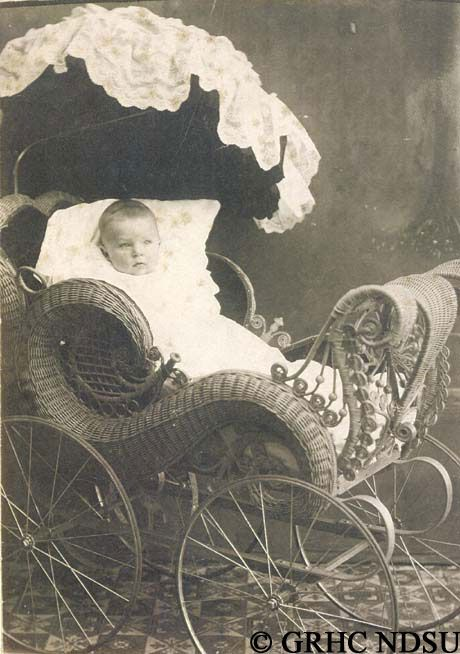 Baby in a wicker buggy