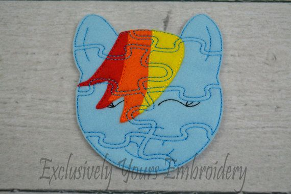 Rainbow Pony felt puzzle! These puzzles are perfect for traveling in the car, on a plane or in a waiting room! Fits easily in a purse or diaper bag! Each finished puzzle comes with a play board with a guide for putting the puzzle together. Terrific for younger children! These felt puzzles can be used to encourage problem solving skills in younger children and are great to hand out as party favors! Each puzzle is machine embroidered and hand cut.  The slightly under 5″x7″ board is sturdy but…