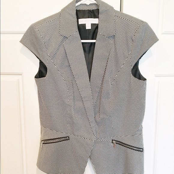 NY and Co: Structure Summer Jacket Super cute with a pair odf dark jeans or black skirt for work. Love this jacket but it is too small for me. New York and Co jacket size 4. Short cap sleeve jacket, checkerboard black and white print, v neck with button closure, 2 silver zipper pockets that are actual pockets. Worn  once or twice. New York & Company Jackets & Coats Blazers