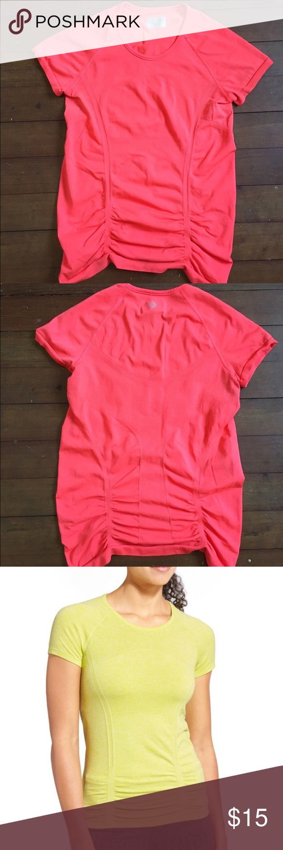 """Athlete Fastest Track Tee Athleta by Gap """"Fastest Track Tee""""                                        This tee is in a bright orange color and is in perfect condition INSPIRED FOR: run, gym/training, studio workouts Raglan sleeves give you room to move More streamlined shirring is fit to flatter Gripper dots along hem stop it from riding up                    50% polyester  45% nylon 5% spandex Athleta Tops Tees - Short Sleeve"""