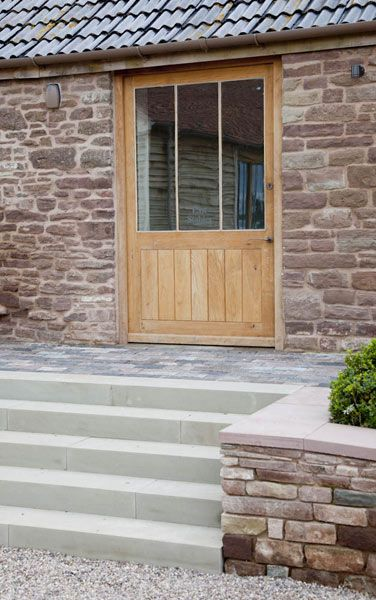 contemporary country - wide oak door and pale stone
