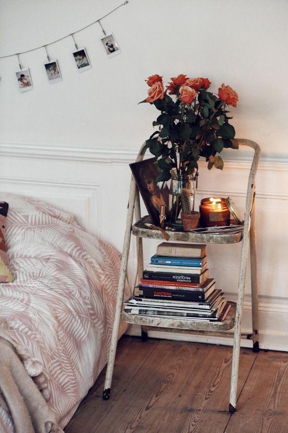 Re-purpose items in your new home! We really like this step ladder as a bedside table, made pretty with flowers, books and a candle. It can be a great option if you're low on funds after moving and need a little bit of extra time to save before you can buy the pieces of furniture you really want.