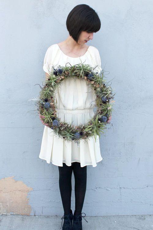 Air plants and hand-dried seasonal flowers create a fresh take on a wreath.