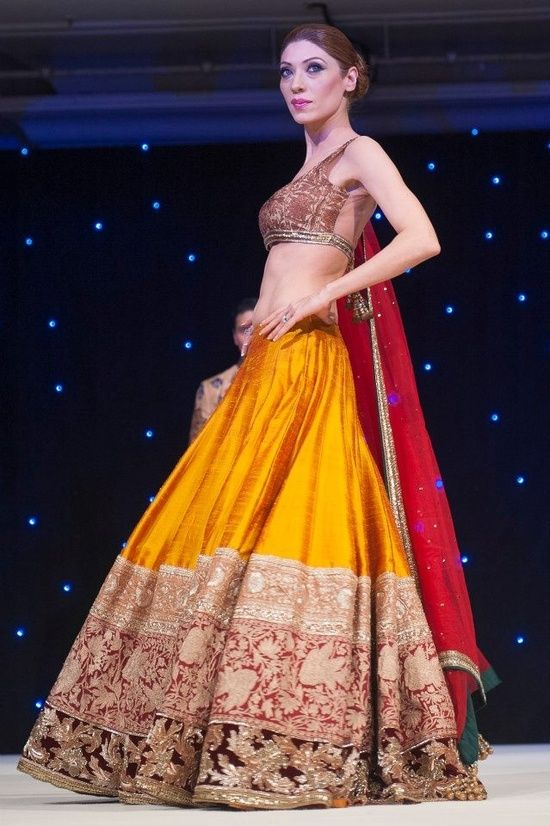 manish lehngas | Yellow colour Manish Malhotra Lehenga with brown border and blouse ...