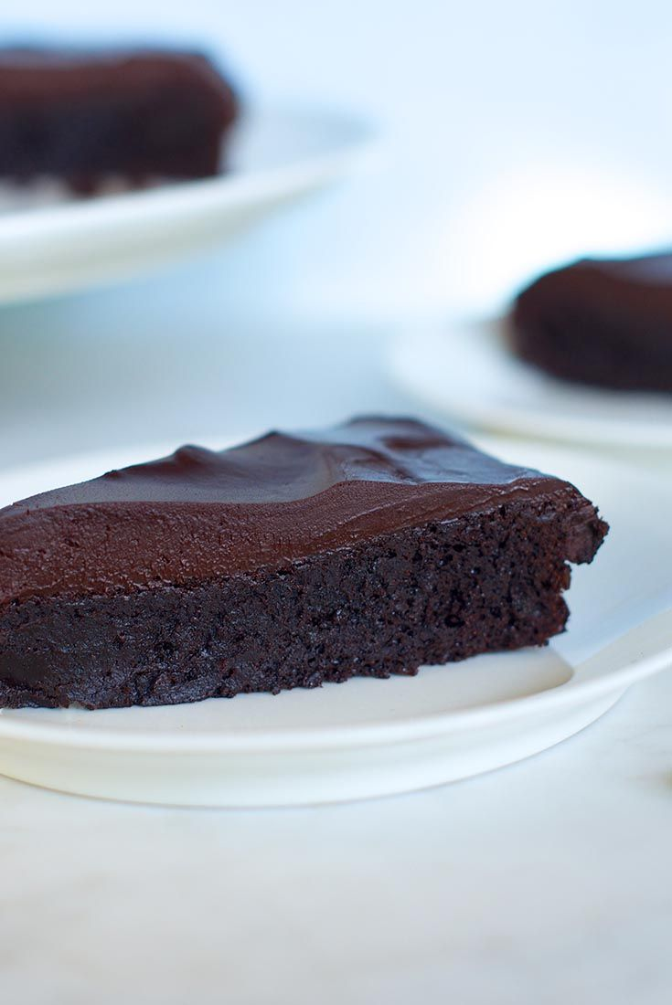 Flourless Chocolate Cake - This flourless cake, featuring both chocolate and cocoa, is rich, rich, RICH! A chocolate ganache glaze takes it over the top.