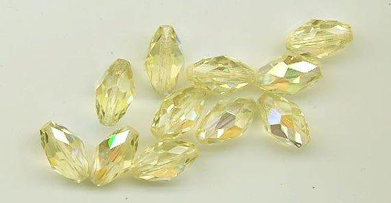 Twelve dazzling vintage West German crystals - machine cut faceted ovals - 12 x 7 mm - jonquil AB