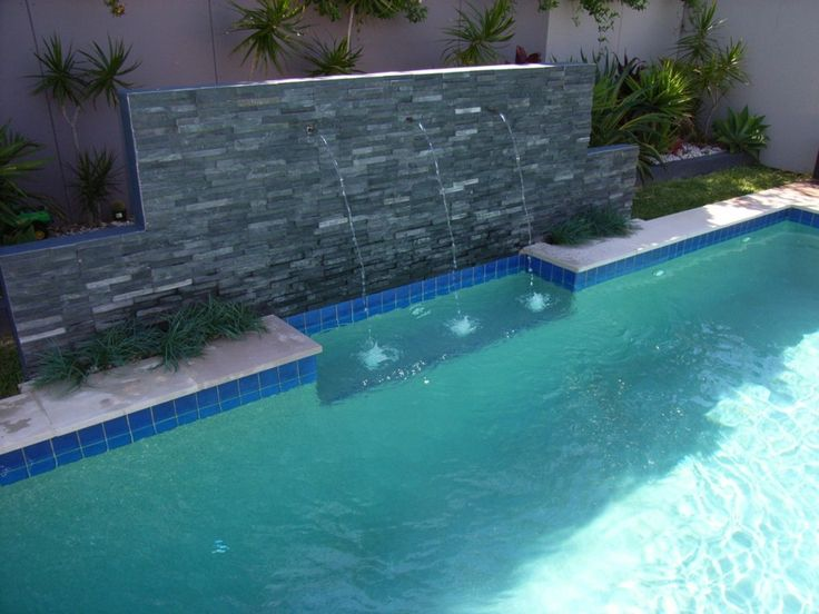 Stunning inground pool waterfall kits with travertine tile pool coping also cobalt blue ceramic - Pool and blues ...