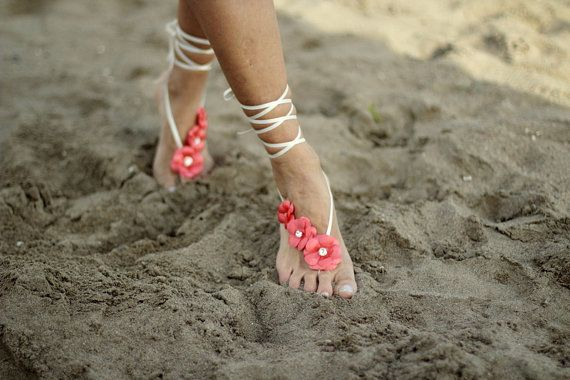 Wear decorative barefoot sandals that coordinate with your color scheme for a wedding on the beach. #BeachWedding #WeddingShoes