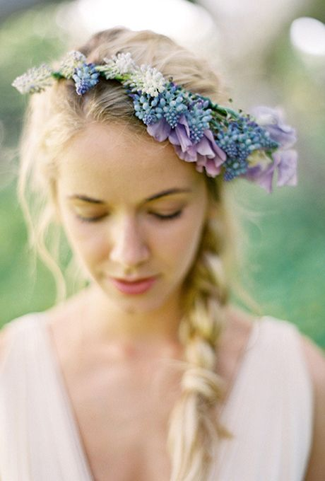 Long Wavy Braided Hair with Muscari Flower Crown. MuscariAlso known as grape hyacinth, this flower develops small, urn-shaped blossoms that are usually purple (symbolizing mystery, calm, and creativity) but also comes in dark blue (for power and confidence).Featured In: Long Wavy Braided Hair with Muscari Flower CrownPhoto:  Jose Villa