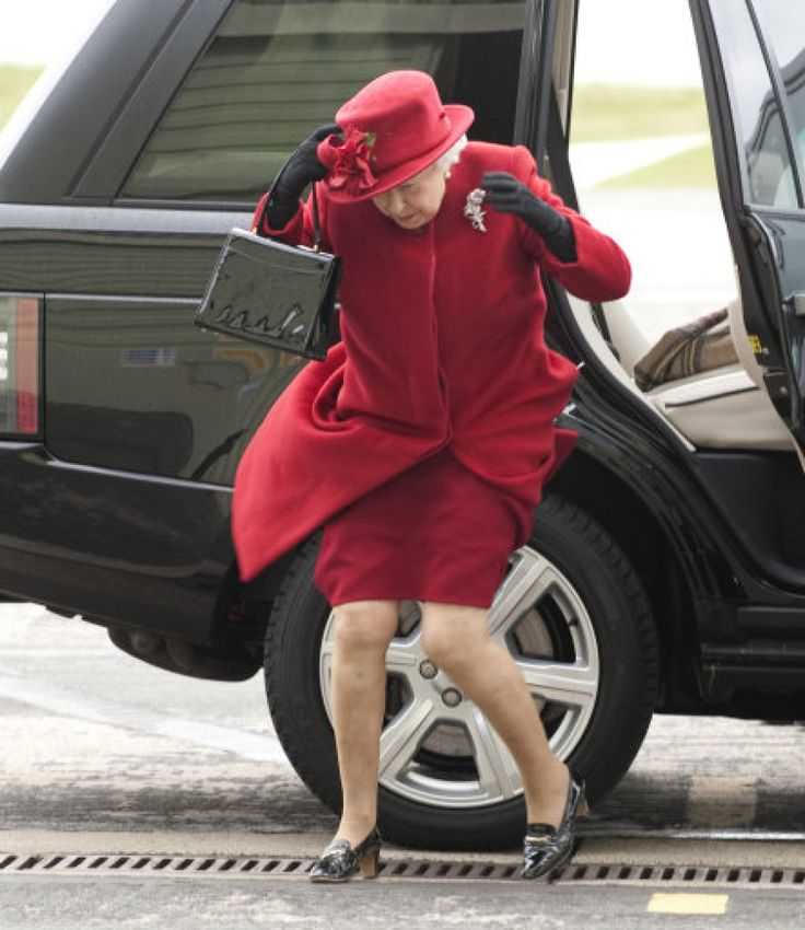 PHOTOS: 30 Funny Pictures Of The Queen ~ HM Queen Elizabeth II deals with a gust of wind.