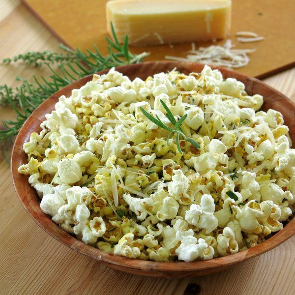 Popcorn coated with a cheesy olive oil mixture and fresh herbs | dinner-mom.com