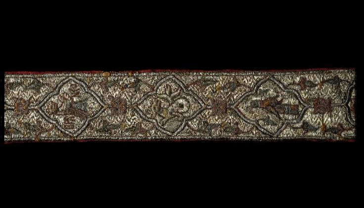 "Branko belt, late Byzantine: Belt in the form of a long embroidered strip, the surface almost covered in couched silver threads; cut ends; design of three repeating motifs in 18 ogival quadrilobal frames: a) a crested helm with mantling, the crest the upper half of a bear, accompanied by an inscription reading ""Branko""; b) a falcon; c) a wyvern with twisted tail; between the frames, a lion's mask, and at the sides, stylised leaves;  British Museum  Registration number: 1990,1201.1"