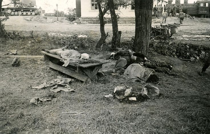 """Nazi-Era Snapshots and the Banality of Evil   VICEYes, a little massacre, with what I believe is a rape. This is surely a woman with her babushka. She's laid on this table with her legs splayed, and she's been made a little comfortable with some straw under her head. I think everybody's dead here: bodies, bodies, bodies. And, the Germans are done now. They're heading to what looks like a small train station. Their backs are all turned away. """"We've done our work and now we're leaving."""