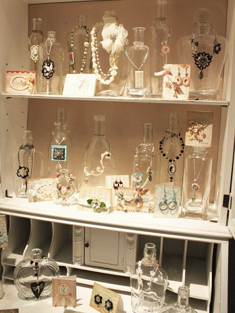 Glass jars to display jewelry, so cute! Would be cute, too if you painted the bottles!