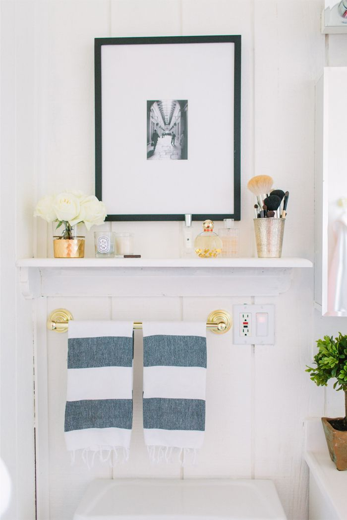 @Alaina Marie Marie Marie Kaczmarski Chicago Apartment Tour // bathroom // @Jay C C Hart Home gold glass // @Kat Ellis spade new york twirl perfume // @Serena &  Lily brass candle holder // @elise West elm striped towels // photography by Stoffer Photography