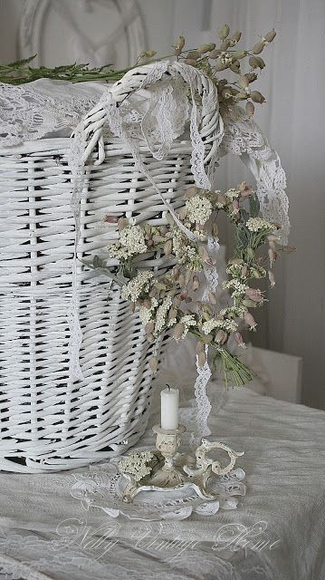 Dried flowers, lace, and wicker
